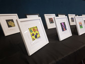 Hand carved lino prints, coloured in ink