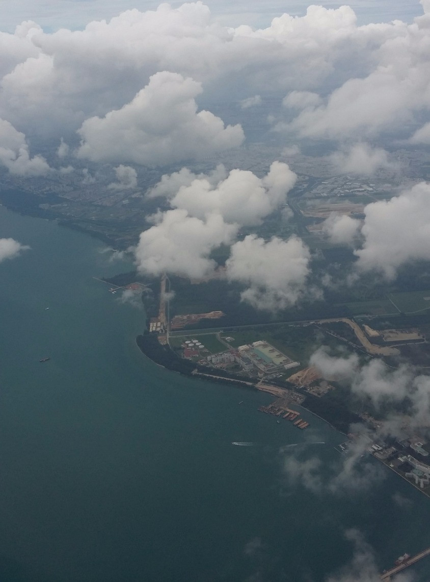 Taken during final approach towards Changi Airport; lots of residential areas of Singapore along its Eastern coast can be seen.