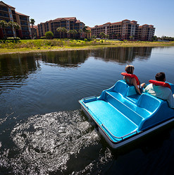 6 Couple in Paddle Boats - Building View