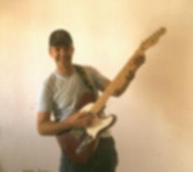 Korey Guitar_edited.jpg