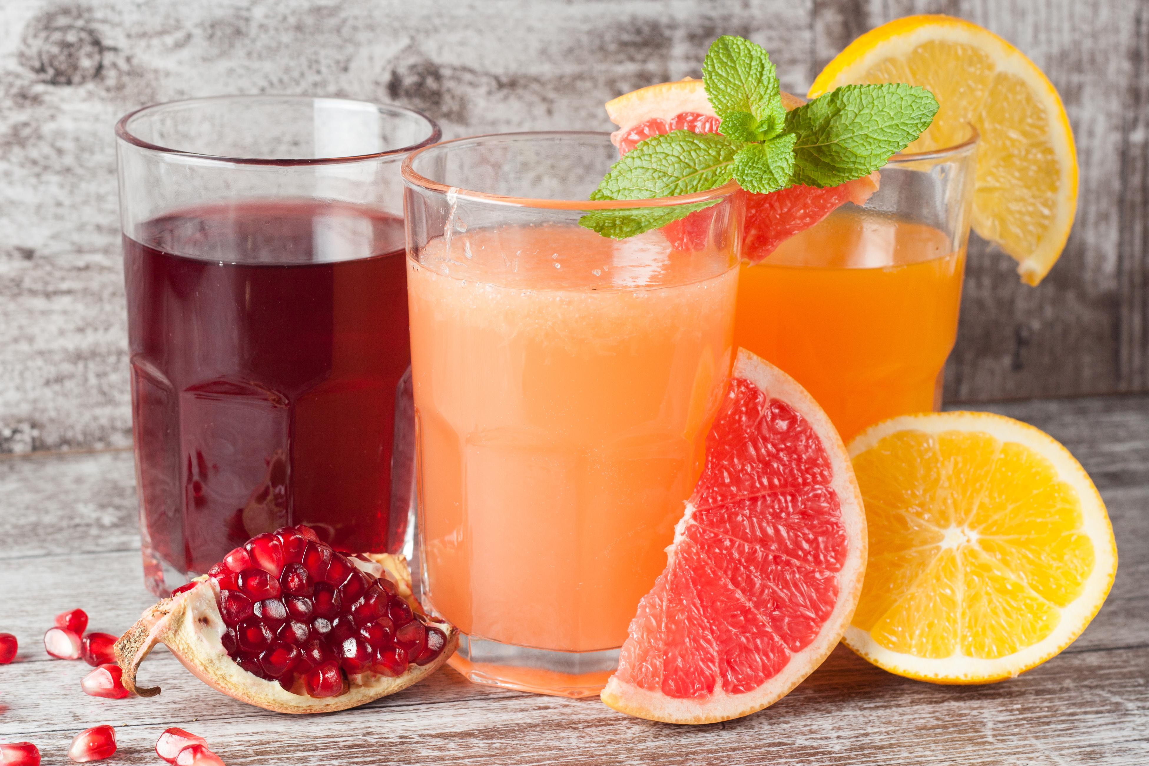Glasses of pomegranate, grapefruit, oran