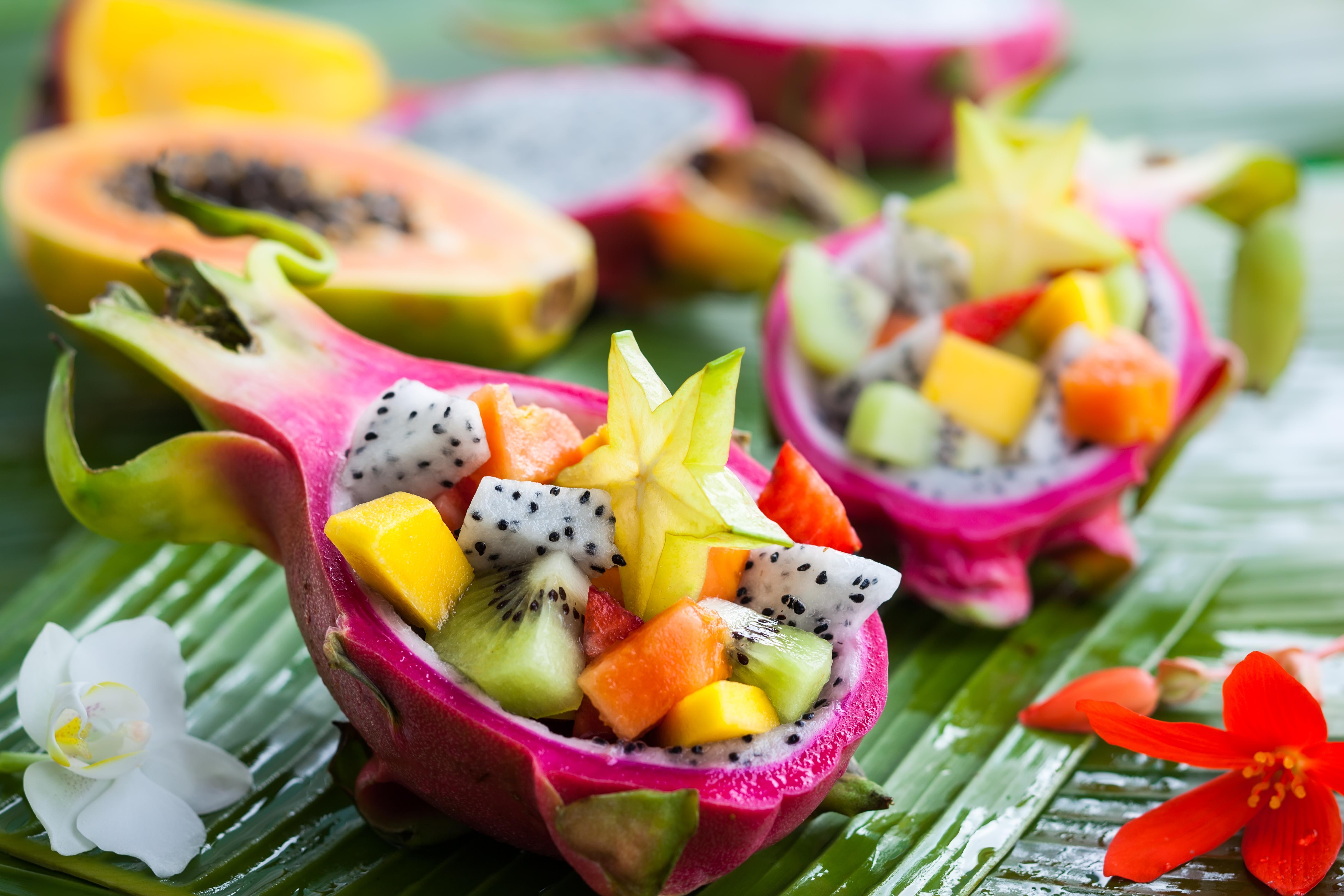 Exotic fruit salad served in half a drag