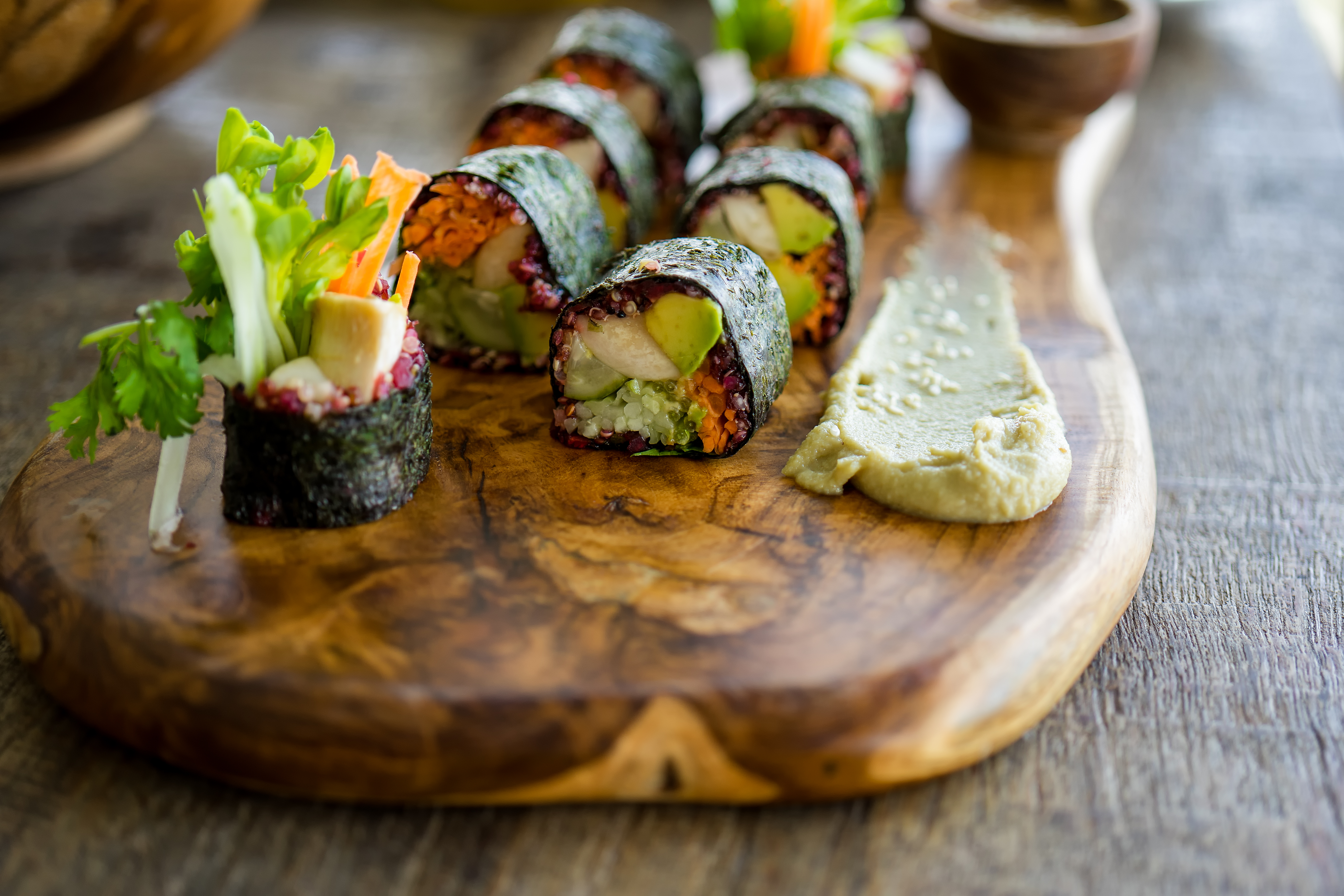 Raw vegan nori hand rolls with pink hors