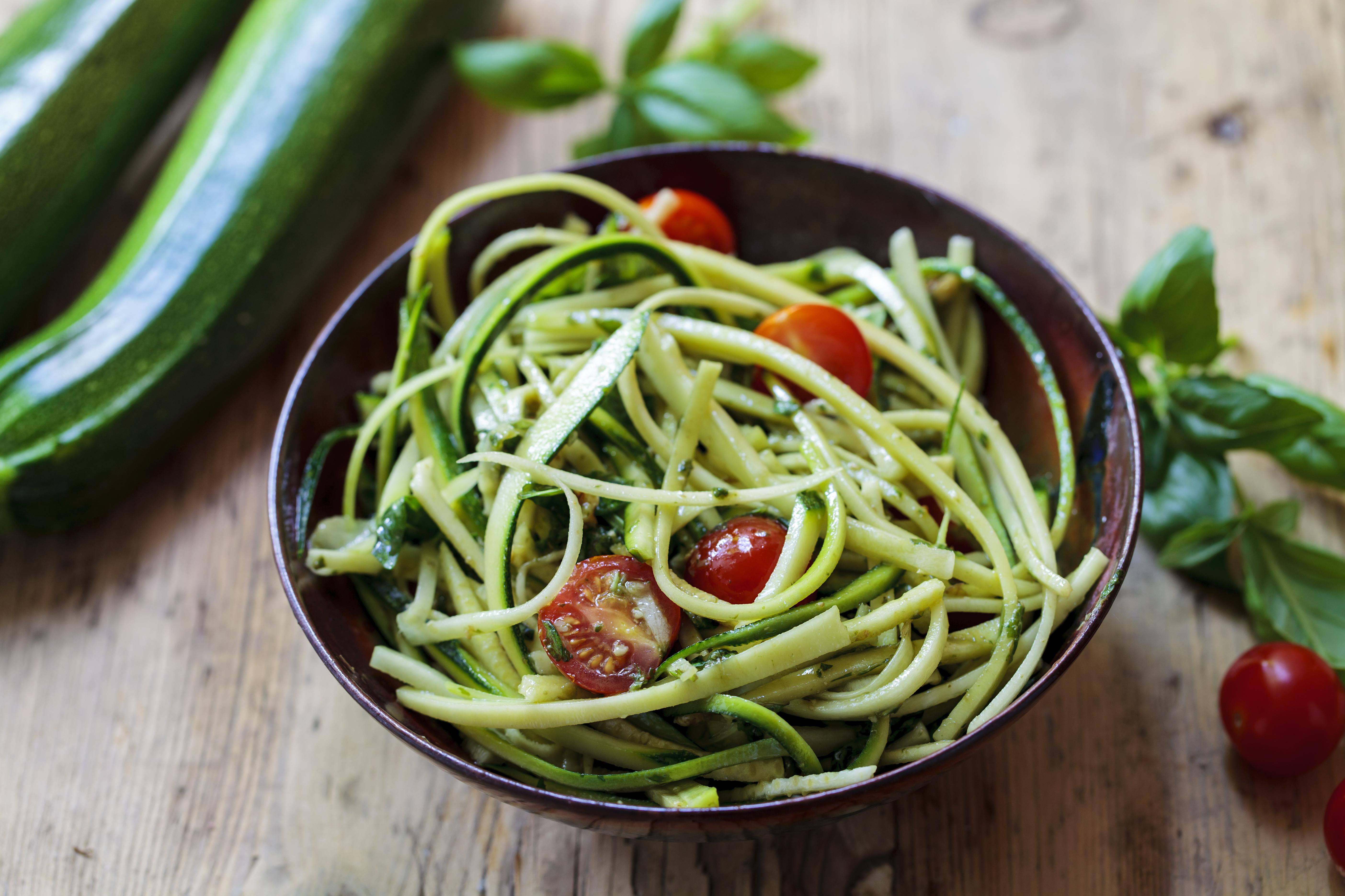 Zucchini spaghetti with rough basil and