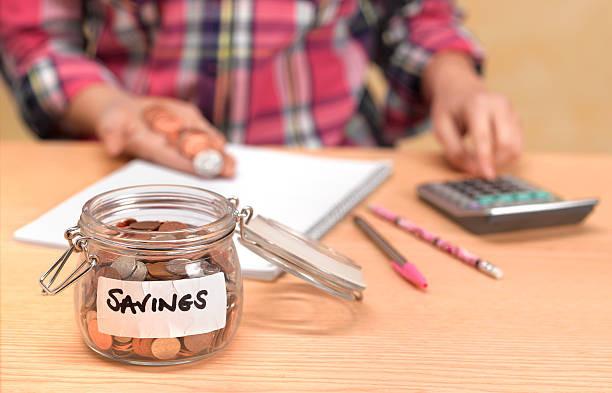 savings glass jar full of pennies