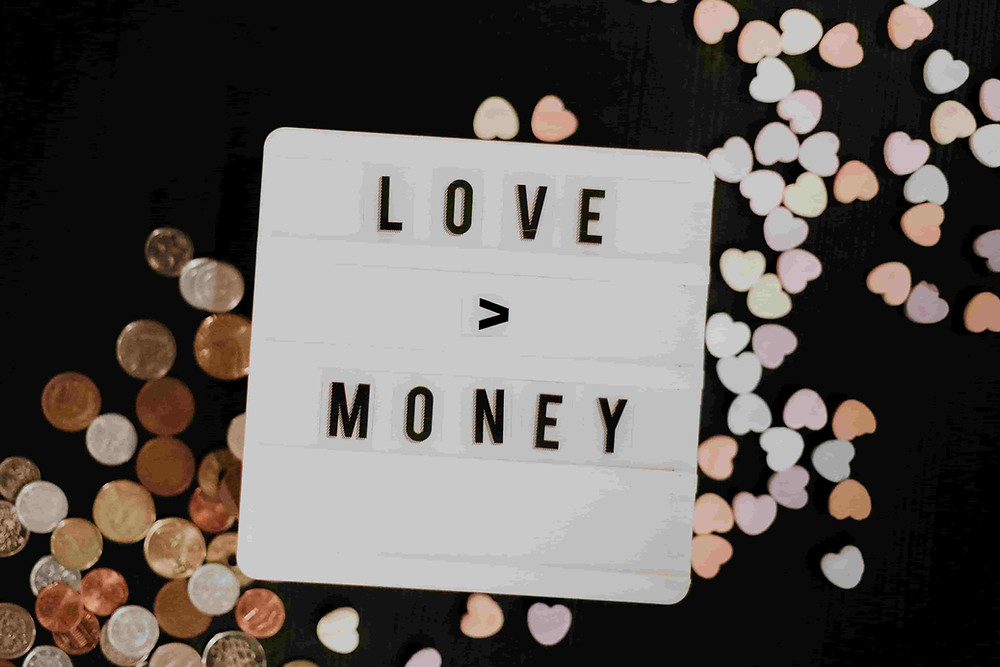 coins and hearts - money can't buy love
