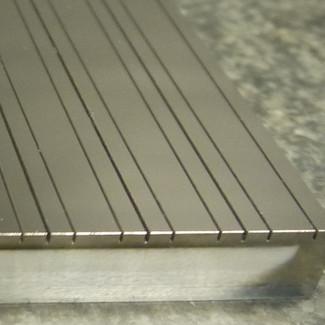 Metallic Neutron Guides