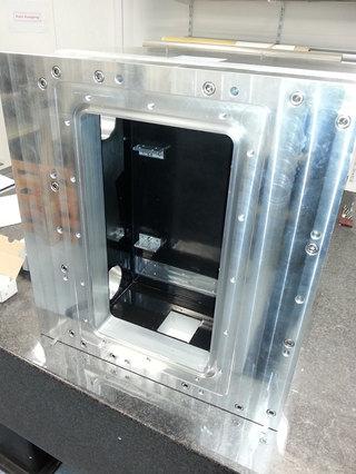 Aluminium vacuum box with translation stage and shilding.