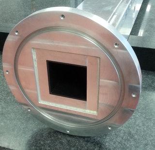 Aluminium vacuum housing with boron shielding.