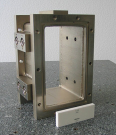 Steel vacuum housing, welded and nickel plated.