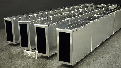Free standing, self evacuated, metallic neutron guide