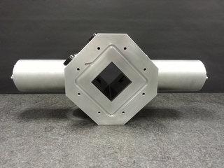 Aluminium vacuum box with beam shaping device.