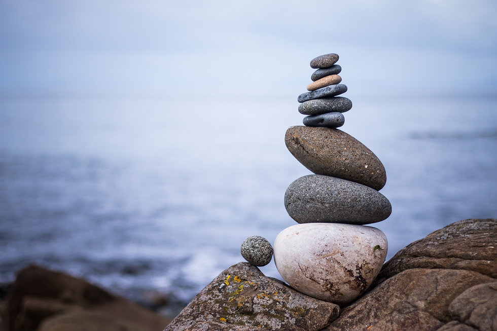 Close up picture of a stone cairn outdoo