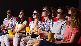 Young friends watching a 3d film at the