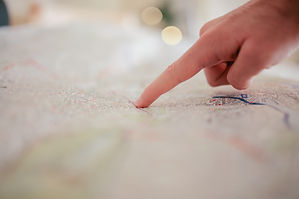 person-pointing-on-white-textile-34753.j