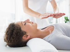 Attractive young woman having reiki trea