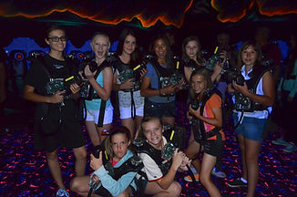 group of girls playing laser tag