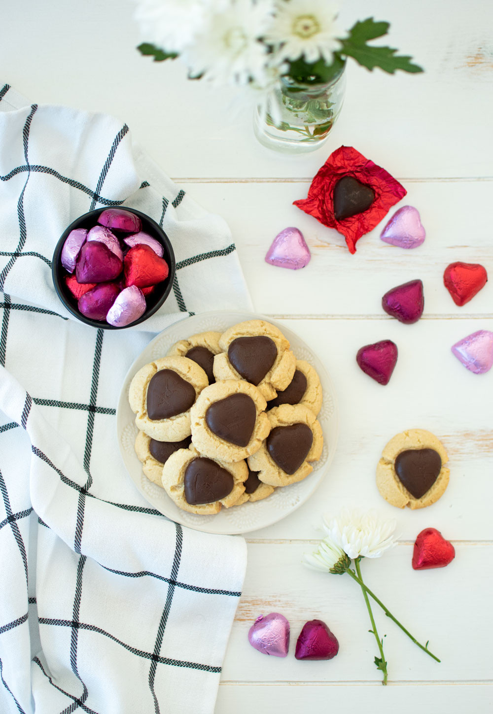 Easy Valentine's Day Heart Thumbprint Cookie recipe, using dark chocolate! Simple thumbprint recipe with chocolate hearts that makes a sweet Valentine's Day cookie #thumbprintcookies #valentinesdaycookies #valentinesday #valentinesdaycandy #valentinesdaychocolate #chocolatethumbprints #thumbprints #highaltitudebaking