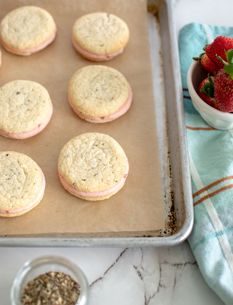 Strawberry Basil Sandwich Cookie recipe that is perfect for Valentine's Day, the best Valentine's Day cookie recipe, strawberry basil recipe, organic cookies, sandwich cookies, high altitude recipes #organic #sandwichcookies #basil #strawberry