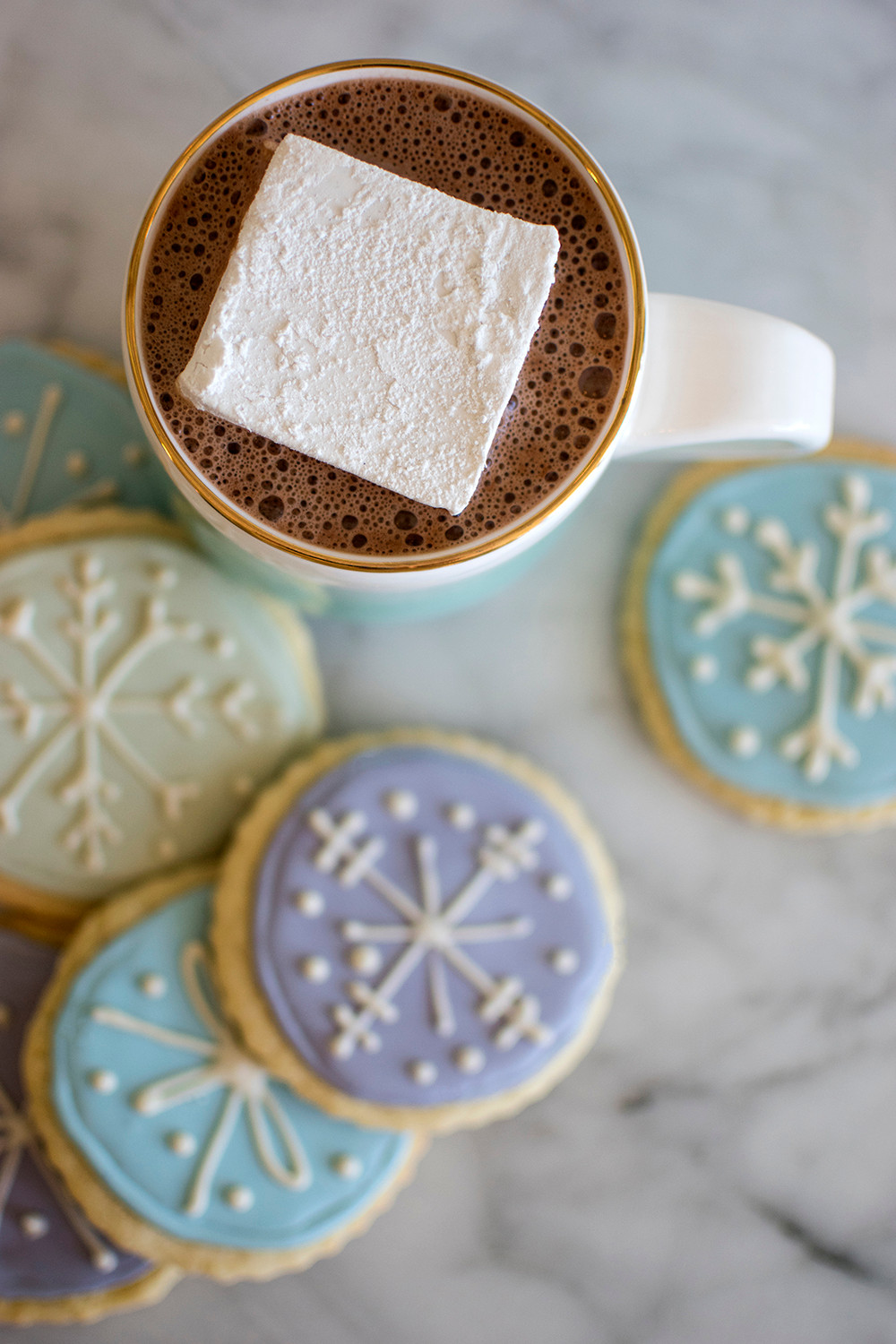 marshmallow dipped in hot cocoa