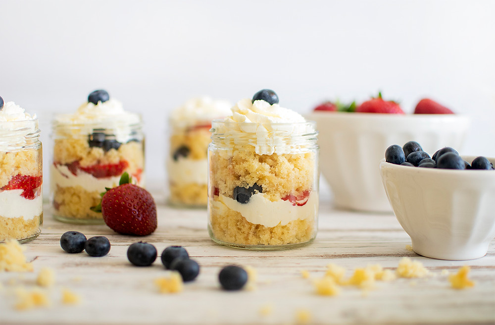 Summer Cake Jars with strawberry and cherries on the floor