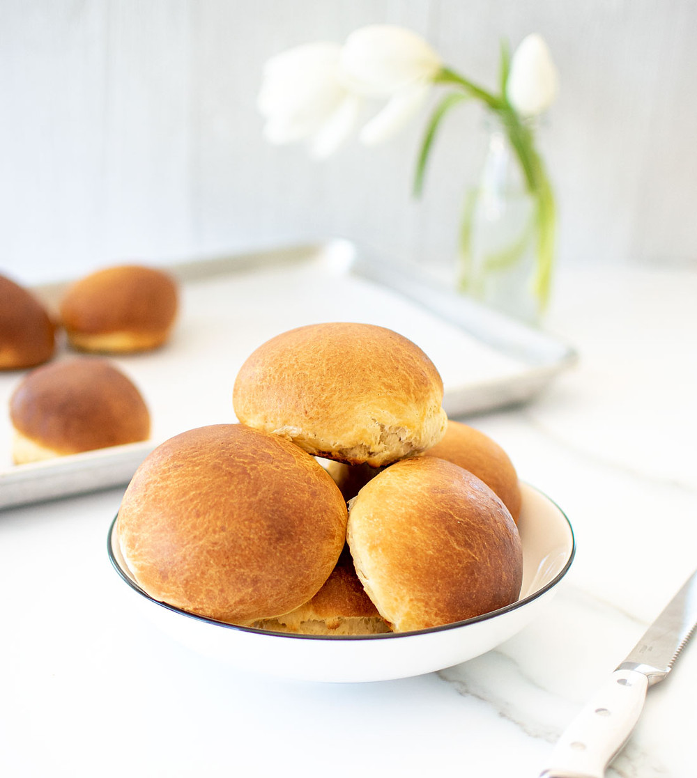 Easy and delicious Brioche Bun recipe. These moist and rich brioche bun recipe is all you need! Perfect for hamburgers or using as a vessel for soup. Brioche buns are rich, fluffy and absolutely delicious buns that are so easy to make. #briochebuns #briocherecipe #brioche #hamburgerbuns #fancybuns #dinnerrolls #organicbread #highaltitudebread