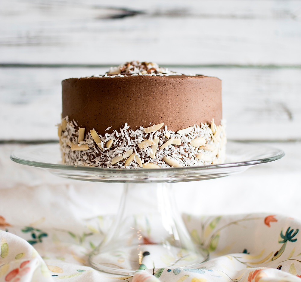 Chocolate Almond Frosting Cake on a cake stand
