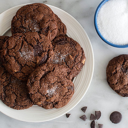 Paleo Sea Salt Chocolate Almond Cookies served in a plate with milk