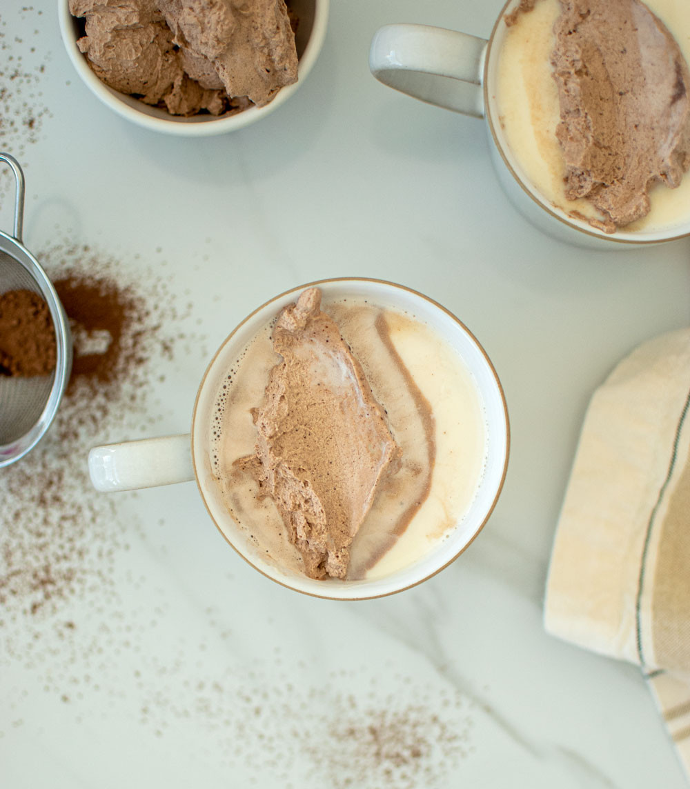 The best white hot chocolate recipe, easy almond White Hot Chocolate with Chocolate Whipped Cream! This simple hot chocolate recipe is a twist on traditional hot chocolate. Making your own homemade chocolate whipped cream is just as easy and oh so delicious #organic #organichotchocolate #hotcocoa #whippedcream #homemadewhippedcream #homemadehotchocolate #chocolatewhippedcream #almondhotchocolate #whitehotchocolate
