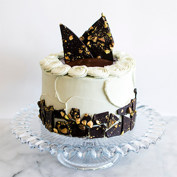Chocolate Pistachio Cake on a cake stand