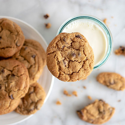 Plate full of Mammoth Chocolate Chip Cookies with a glass of milk
