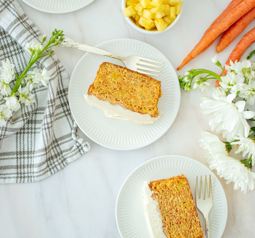 Easy Frosted Carrot Loaf Cake with Cream Cheese Icing recipe. This carrot quick bread comes together so easily, you can make it in one bowl! Moist, sweet, and a little tangy with cream cheese frosting. This carrot loaf cake recipe can be enjoyed for breakfast or dessert! #organic #organiccake #carrotcake #creamcheesefrosting #creamcheeseicing #carrotquickbread