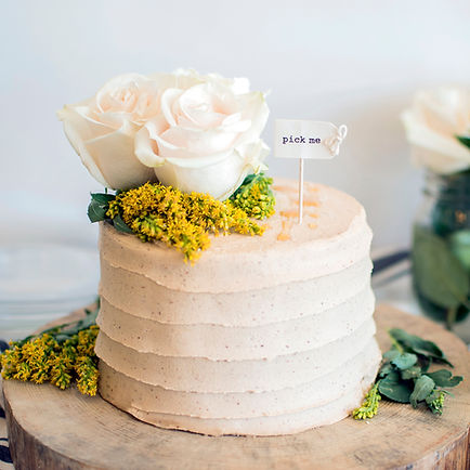 Small wedding cake with flowers on top