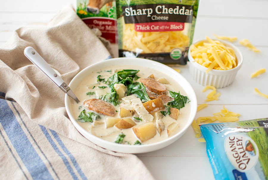 Healthy and easy Creamy Sausage Potato & Kale Soup recipe that's perfect for cozy fall days! This easy soup makes a lot so you'll have soup for days or enough to feed a large family #soup #easy #easyrecipe #easysoup #creamysoup #healthyrecipe #healhtysoup #fallrecipe