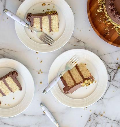 Cake slices being enjoyed on plates