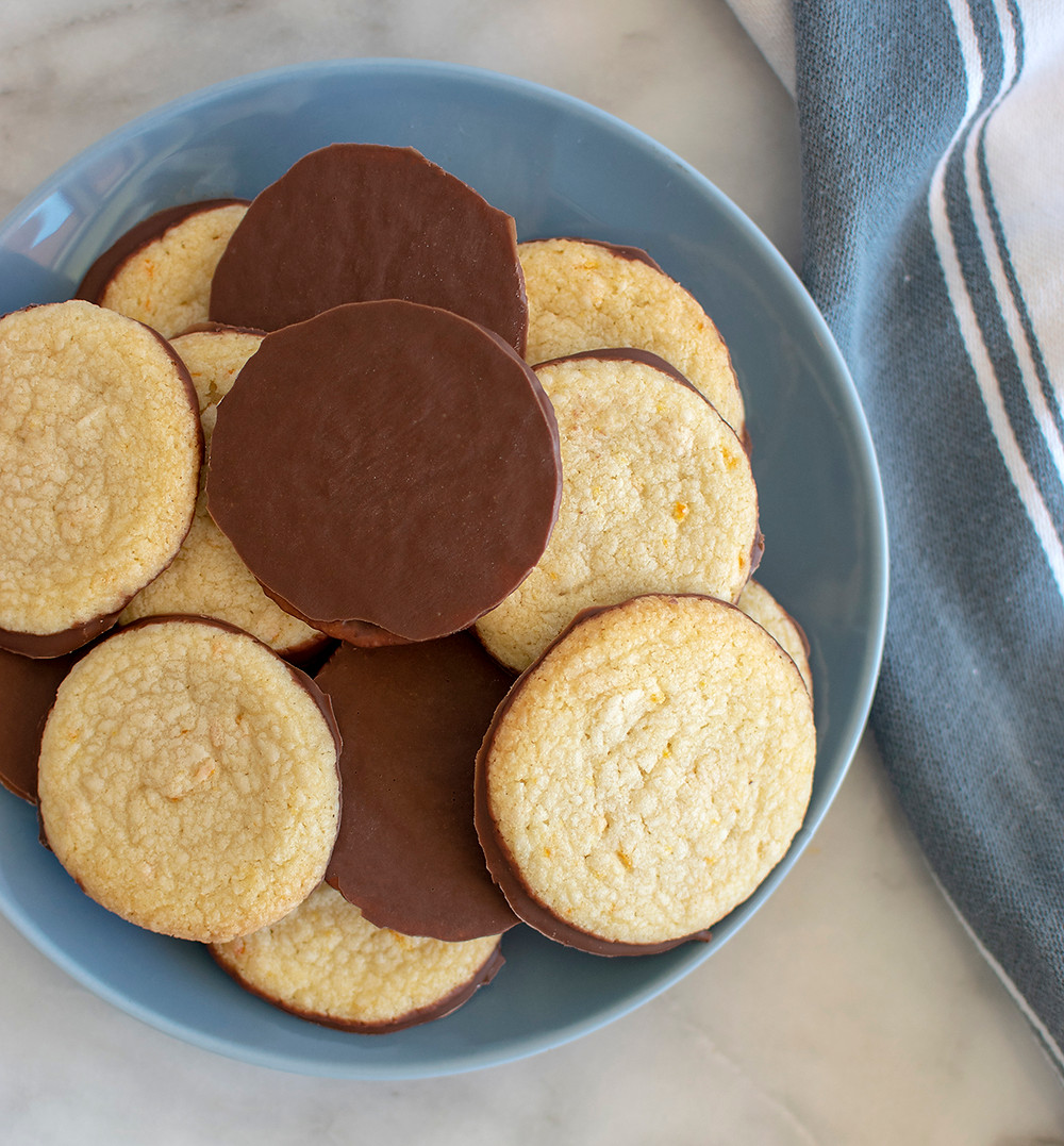 Top view of plate full of Milk Chocolate Orange Shortbread Cookies