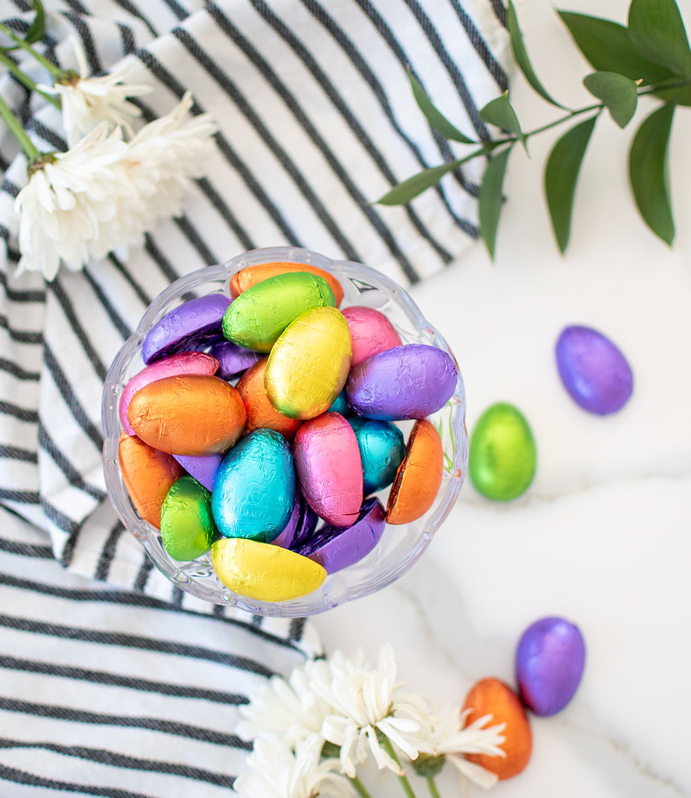 Easy completely organic Easter Bunny Cake recipe, that is so easily decorated! If you're looking for an easy Easter bunny cake recipe, this is it! This completely organic Easter cake is just what you want to bake to celebrate Easter Sunday. Using organic chocolate Easter bunny and organic chocolate filled Easter eggs. #organiceaster #eastereggs #organicchocolate #easterbunny #chocolatebunny #organiceastercandy #organiccandy #eastercake #easterbunnycake