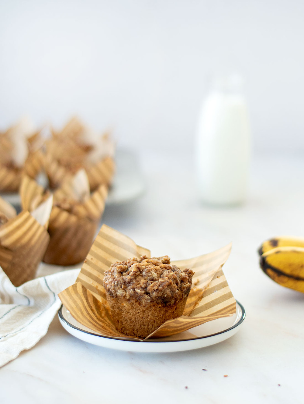 Easy and simple healthy Brown Sugar Banana Muffin recipe. This recipe uses overly ripe bananas to make the best healthy and delicious banana muffins. They have a crumble top which makes them even more yummy! #organicmuffins #highaltitudebaking #bananamuffins #brownsugarmuffins #healthymuffins #organicbaking