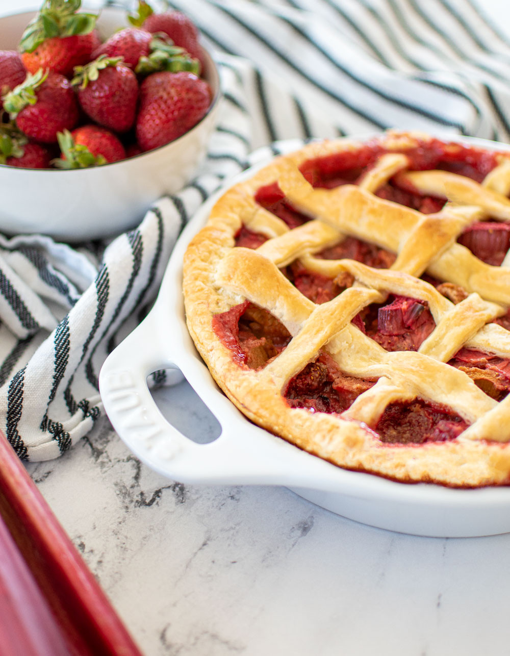 From scratch Strawberry Rhubarb Pie recipe using fresh rhubarb and fresh strawberries. This eggless Strawberry Rhubarb Pie recipe is so easy to make and you'll love sharing this with your family this spring. I use a milk wash instead of an egg wash, so it makes this pie recipe eggless. #egglesspie #organicpie #strawberryrhubarb #strawberryrhubarbpie #homemadepie #fromscratch #fromscratchpie