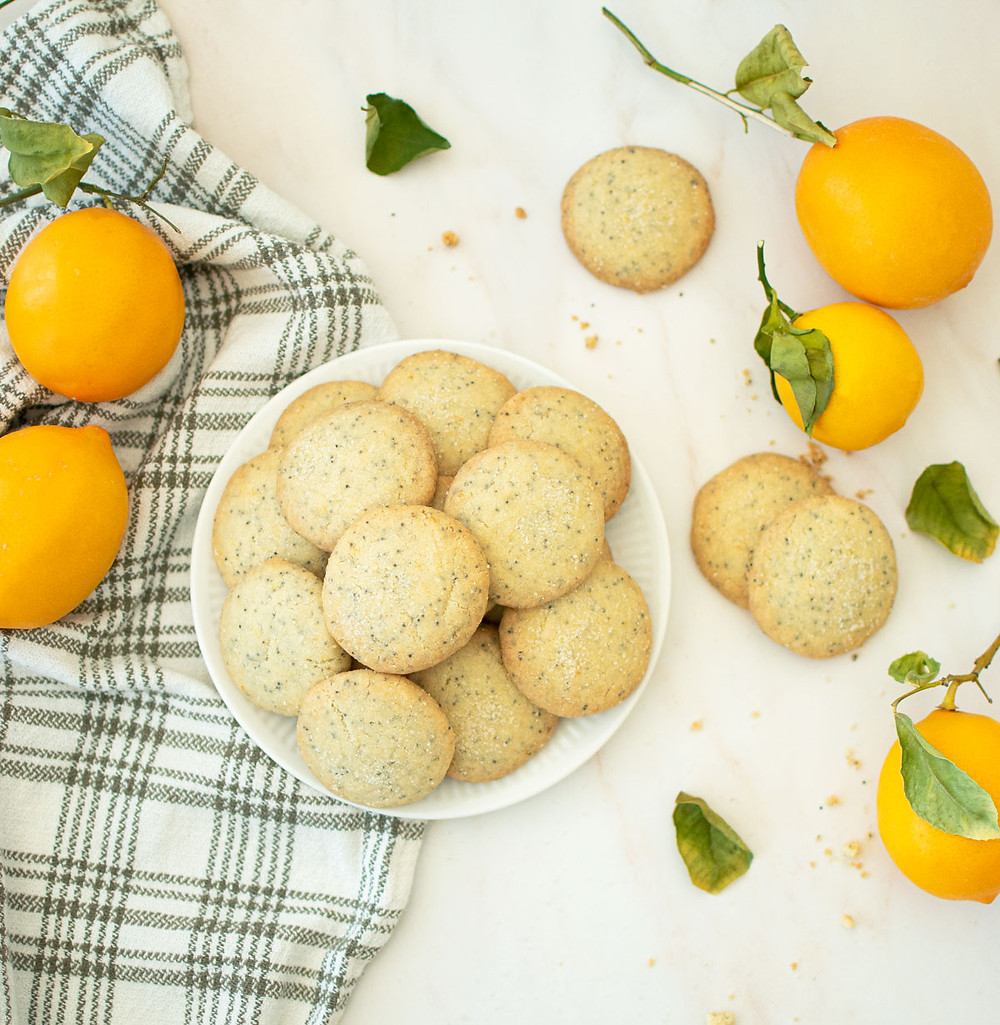 Easy 6 ingredient Mini Meyer Lemon Shortbread Cookie recipe. These mini cookies are so good and so easy to make! Using fresh Meyer lemons and just a few simple ingredients, make the best shortbread cookies. #organiccookies #cookierecipe #shortbreadcookies #shortbreads #6ingredients #meyerlemon