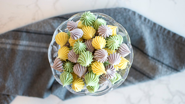 A bowl full of Pastel Cream Cheese Mints