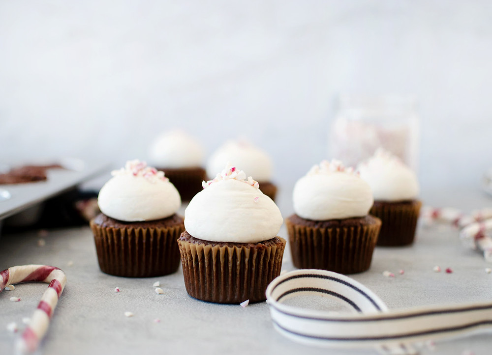 The best Christmas cupcake recipe is this easy and festive Peppermint Bark Cupcakes. The whole family will love these simple and easy cupcakes for the holidays! Get the recipe for these delicious Peppermint Bark Cupcakes #cupcakes #peppermint #peppermintbark #chocolate #chocolatecupcakes #christmas #christmascupcakes #holidays #organic #organiccupcakes #glutenfree #glutenfreecupcakes #highaltitudebaking
