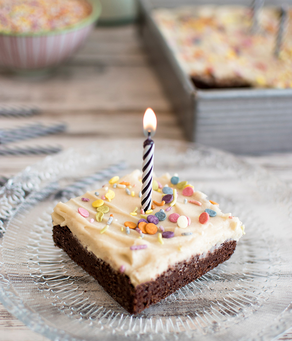 piece of Chocolate Cake with lighted candle on it