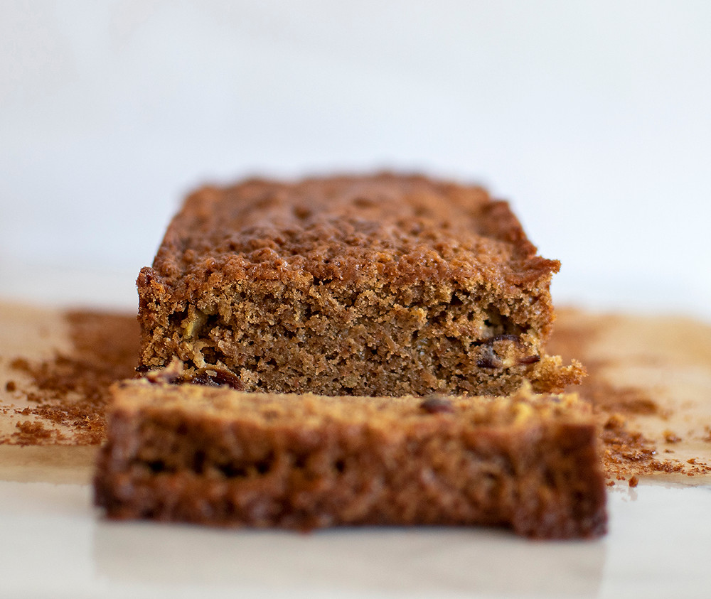 Slicing of Spiced Cranberry Carrot Bread