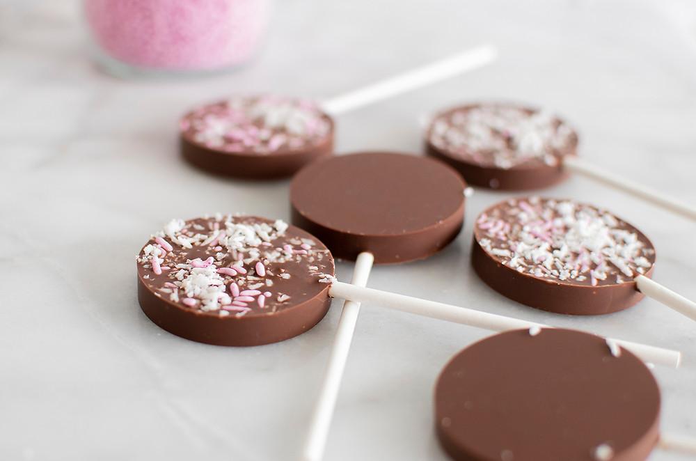 Lots of Milk Chocolate Valentine's Day Lollipops on floor