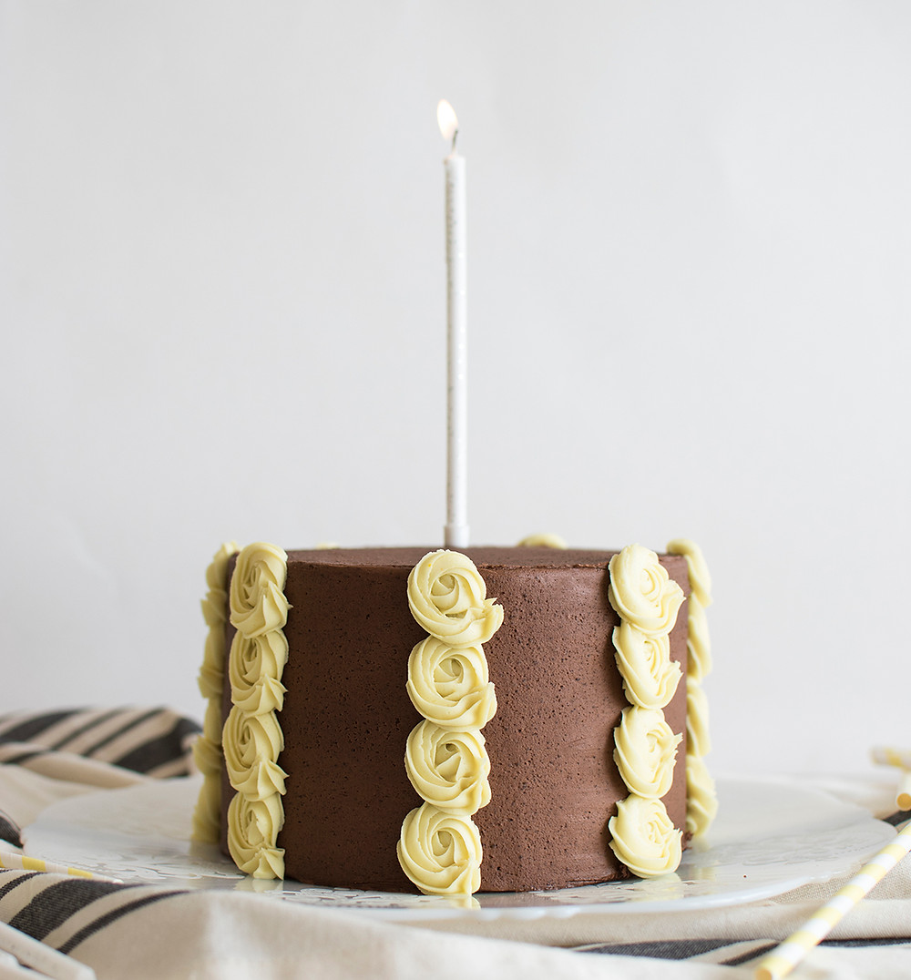 side view of Ombre Cake with candle lighted on it