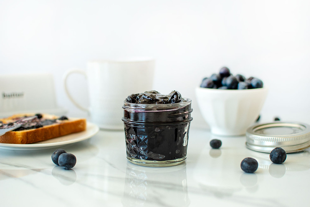 Easy Blueberry Preserves recipe that uses no pectin. This delicious blueberry jam is a healthy recipe you'll want to make all the time. Perfect for topping toast, canning, giving as gifts or using in baked goods #blueberry #preserves #blueberryjam #homemadejam #canning #canningjam #organicjam #organicpreserves #homemadejelly