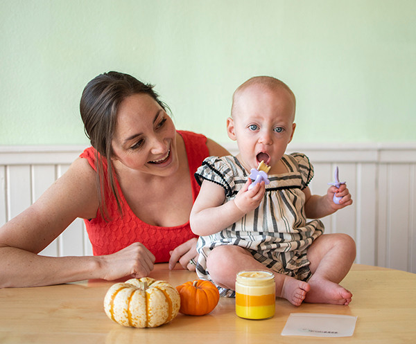 Baby eating Candy Corn Pudding from the jar