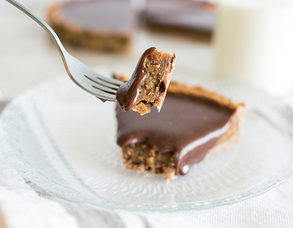 Eating Milk Chocolate Peanut Butter Tart with a fork