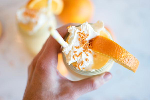 Holding jar of Orange Cream Milkshakes in hand